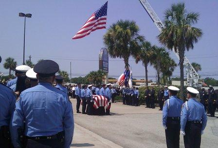 Honor Guard prepares to fold flag of Officer Henry Canales