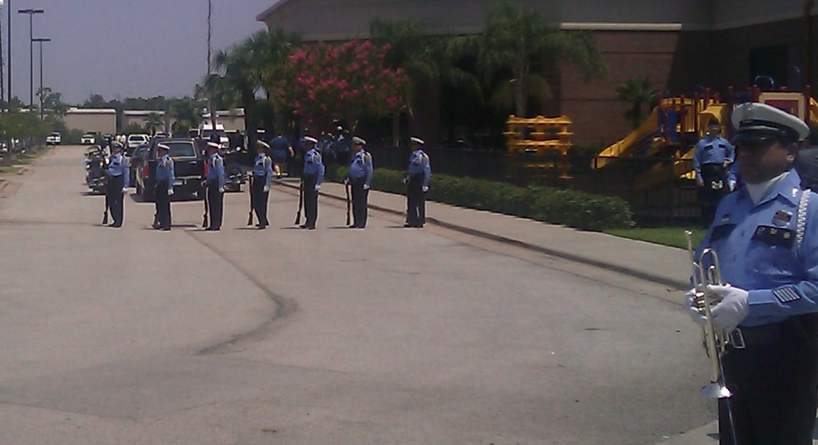 Honor Guard prepares to deliver Taps and Rifle Volley for Officer Henry Canales