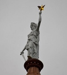 Red Tailed Hawk Perched on Lady Liberty atop Texas Capitol in Austin