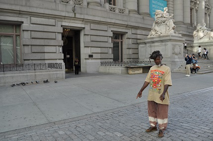 Dub Poet Infinity points to site of human rights abuses on the grounds of the Southern District of New York Bankruptcy Courts