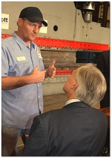 Greg Abbott listens to worker at Mach Industrial Group