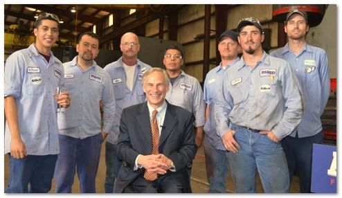 Greg Abbott with workers at Mach Industrial Group