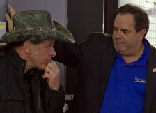 Photo by Daniel Conreras -  Ted Nugent and Bob Price discuss Obama Shooting Photo at Tactical Firearms before Piers Morgan interview