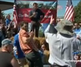 Mitt Romney Heckled by progressives at Iowa State Fair